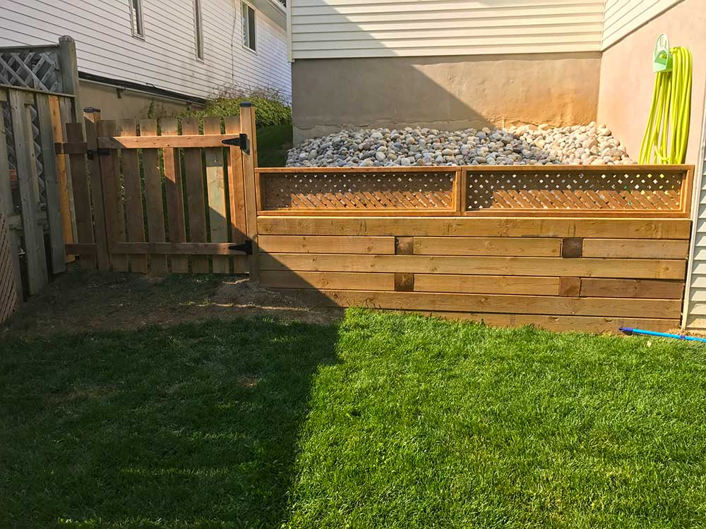 how to fix a wood retaining wall